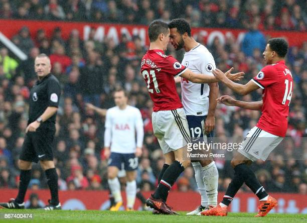 Ander Herreran of Manchester United clashes with Mousa Dembele of Tottenham Hotspur during the Premier League match between Manchester United and...