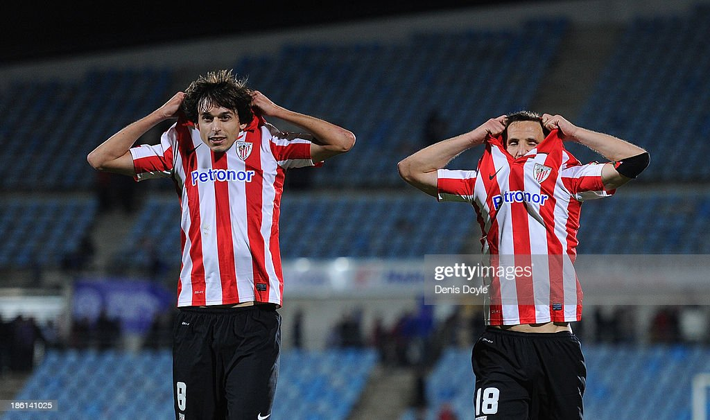 Ander Iturraspe (L) and Carlos Gurpegui of Athletic Club celebrate after beating Getafe CF 1-0 during the La Liga match between Getafe CF and Athletic Club at Coliseum Alfonso Perez stadium on October 28, 2013 in Getafe, Spain.