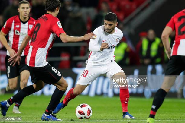Ander Iturraspe of Athletic Bilbao Ever Banega of Sevilla FC during the La Liga Santander match between Athletic de Bilbao v Sevilla at the Estadio...