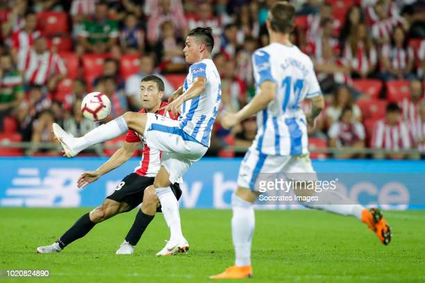 Ander Iturraspe of Athletic Bilbao Jonathan Silva of Leganes during the La Liga Santander match between Athletic de Bilbao v Leganes at the Estadio...