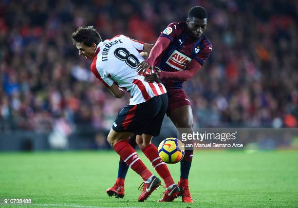 Ander Iturraspe of Athletic Club being fouled by Pape Diop of SD Eibar during the La Liga match between Athletic Club and Eibar at Estadio San Mames...