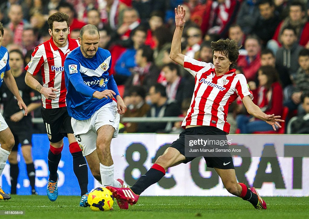 Ander Iturraspe of Athletic Club Bilbao competes for the ball with Fernando Soriano of UD Almeria during the La Liga match between Athletic Club Bilbao andÊUD AlmeriaÊat San Mames Stadium on January 11, 2014 in Bilbao, Spain.