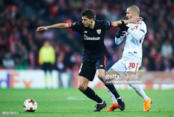 Ander Iturraspe of Athletic Club competes for the ball with Sofiane Hanni of FC Spartak Moskva during UEFA Europa League Round of 32 match between...
