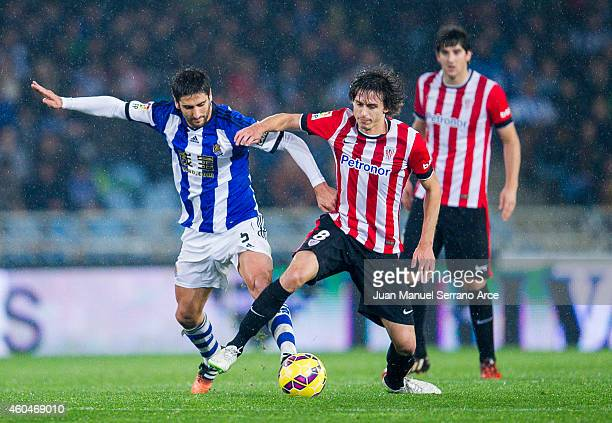 Ander Iturraspe of Athletic Club duels for the ball with Markel Bergara of Real Sociedad during the La Liga match between Real Sociedad and Athletic...