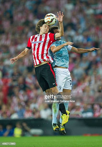 Ander Iturraspe of Athletic Club duels for the ball with Mikel Arruabarrena of SD Eibar during the La Liga match between Athletic Club and SD Eibar...