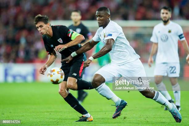 Ander Iturraspe of Athletic Club duels for the ball with Salisu Abdullhi Gero of Ostersunds FK during the UEFA Europa League group J match between...