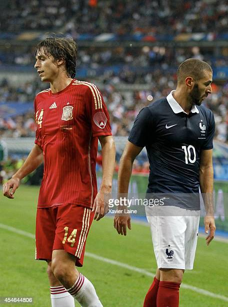 Ander Iturraspe of Spain and Karim Benzema of France during the International Friendly match between France and Spain at Stade de France on september...