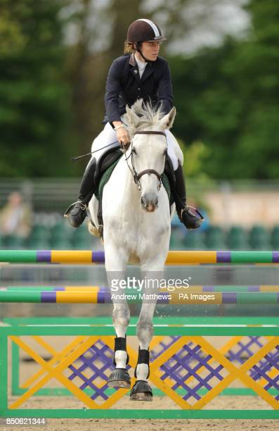 Anderida Polaris ridden by Rachel Keevil jumps a fence during the Grades B C Handicap Jumping during day one of the Royal Windsor Horse Show at...