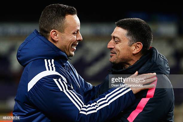 Anderlecht Coach Mohamed Ouahbi and Barcelona Coach Francisco Javier Garcia Pimienta share a joke prior to the UEFA Youth League Round of 16 match...