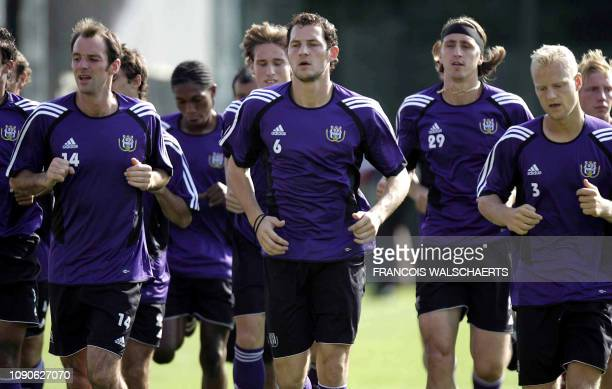 Anderlecht football players Bart Goor Jelle Van Damme and Olivier Deschacht attend a training session 12 September 2006 in Brussels on the eve of...