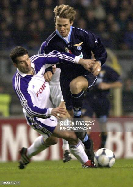 Anderlecht's Aleksandar Ilic and Lazio Roma's Sinisa Mihajlovic fight for the ball during their Champions League 2nd round group D soccer match RSC...