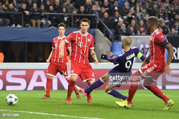 Anderlecht's Algerian midfielder Sofiane Hanni kicks to score a goal during the UEFA Champions League Group B football match between Anderlecht and...