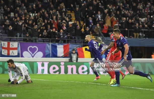 Anderlecht's Algerian midfielder Sofiane Hanni reacts after scoring a goal past Bayern Munich's German goalkeeper Sven Ulreich during the UEFA...