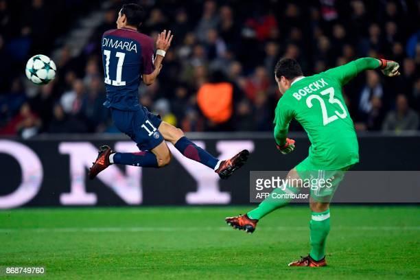 Anderlecht's Belgian goalkeeper Frank Boeckx kicks the ball past Paris SaintGermain's Argentinian forward Angel Di Maria during the UEFA Champions...