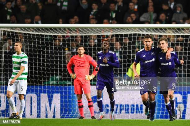 Anderlecht's Belgian midfielder Leander Dendoncker and Anderlecht's Belgian midfielder Pieter Gerkens celebrates the own goal scored by Celtic's...