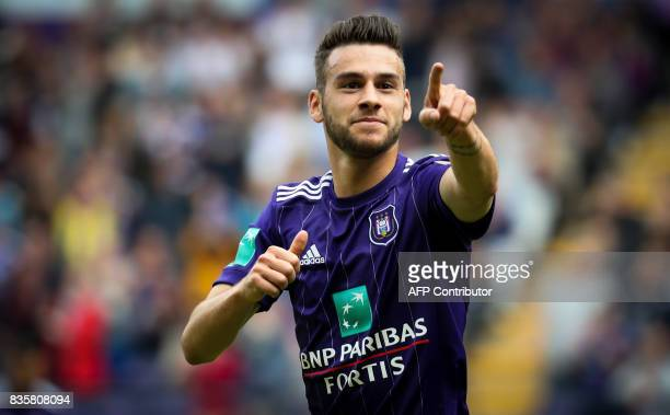 Anderlecht's Belgian midfielder Massimo Bruno celebrates after scoring a goal during the Belgian Jupiler Pro League football match between Sporting...