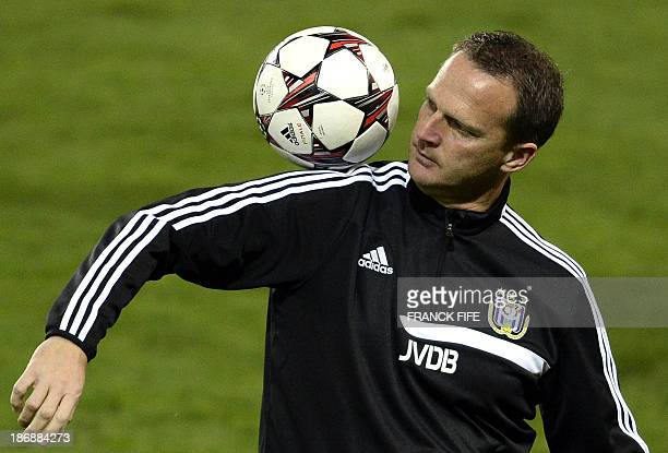 Anderlecht's Dutch head coach John van den Brom juggles with a ball during a training session at the Parc des Princes stadium in Paris on November 4...