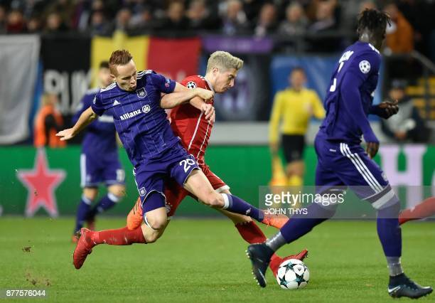 Anderlecht's French midfielder Adrien Trebel vies with Bayern Munich's Polish forward Robert Lewandowski during the UEFA Champions League Group B...