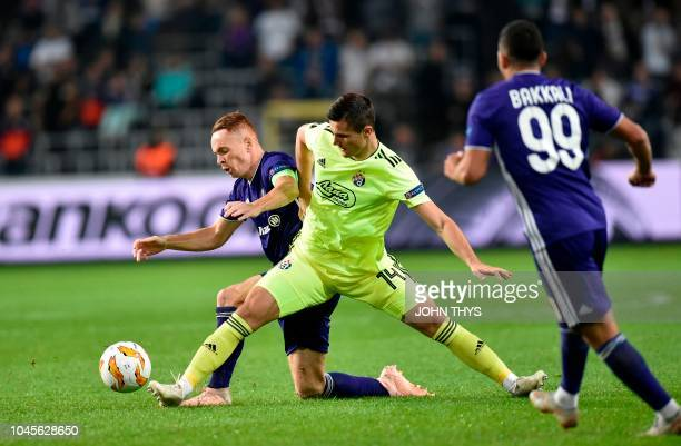 Anderlecht's French midfielder Adrien Trebel vies with Dinamo Zagreb's Bosnian midfielder Amer Gojak during the Europa League Group D football match...
