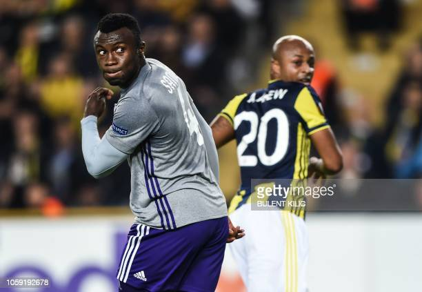 Anderlecht's Gambian defender Bubacarr Sanneh reacts as Fenerbahce's Andre Ayew celebrates after scoring during the UEFA Europa League Group D...