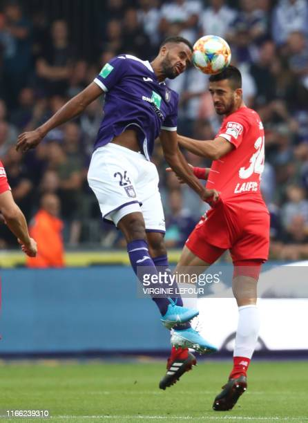 Anderlecht's Isaac Kiese Thelin and Standard's Konstantinos Kostas Laifis fight for the ball during a soccer match between RSC Anderlecht and...