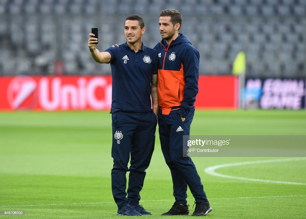 Anderlecht's midfielders Alexandru Chipciu (R) and Nicolae Stanciu (L) take a picture during a first visit prior the team training session ahead the first Champions League group B match between Bayern Munich and RSC Anderlecht at the stadium in Munich, southern Germany, on September 11, 2017. / AFP PHOTO / Christof STACHE
