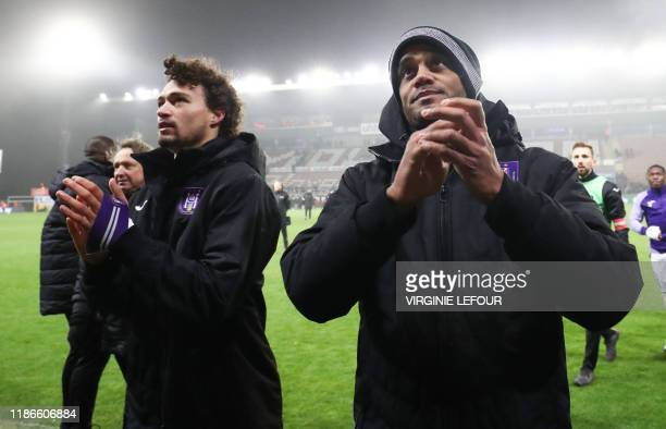 Anderlecht's Philippe Sandler and Anderlecht's Vincent Kompany celebrate after winning a soccer match between Royal Excel Mouscron and RSC...