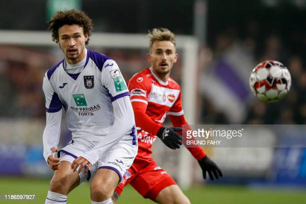 Anderlecht's Philippe Sandler and Mouscron's Aleix Garcia fight for the ball during a soccer match between Royal Excel Mouscron and RSC Anderlecht,...