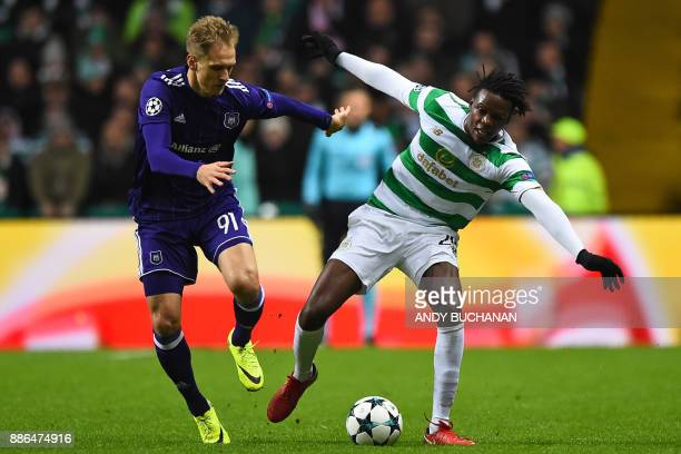 Anderlecht's Polish striker Lukasz Teodorczyk vies with Celtic's Belgian defender Dedryck Boyata during the UEFA Champions League Group B football...