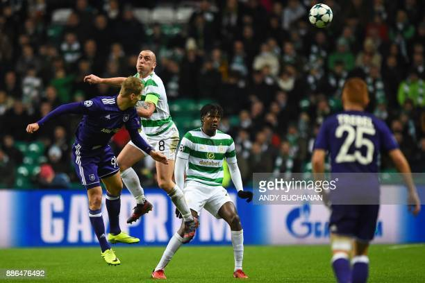 Anderlecht's Polish striker Lukasz Teodorczyk vies with Celtic's Scottish midfielder Scott Brown during the UEFA Champions League Group B football...
