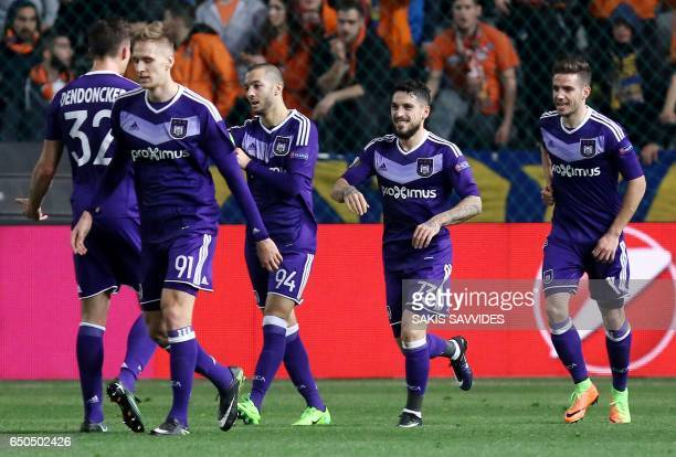 Anderlecht's Romanian midfielder Nicolae Stanciu celebrates with teammates after scoring his team's opening goal during the Europa League round of 16...