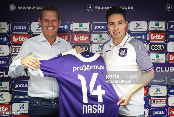 Anderlecht's technical director Frank Arnesen and Anderlecht's new player French midfielder Samir Nasri pose for a photo session with the new jersey...