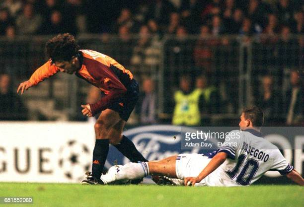 Anderlecht's Walter Baseggio slides in on Roma's Damiano Tommasi