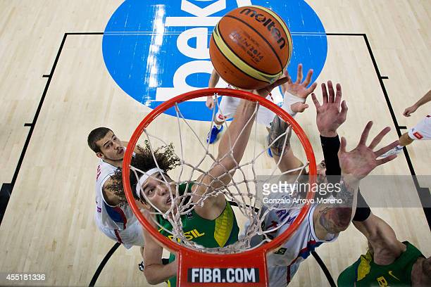 Anderon Varejao of Brazil shoots against Miroslav Raduljica of Serbia during the 2014 FIBA World Basketball Championship quarter final match between...