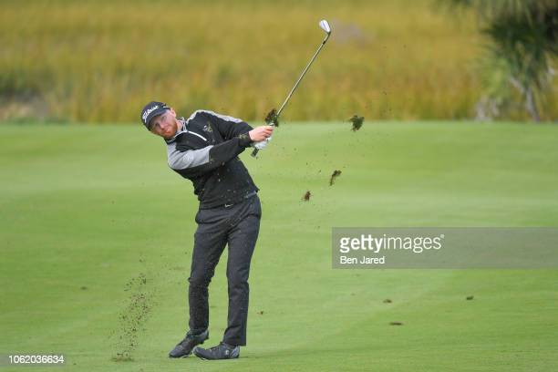 Anders Albertson hits a shot on the eighth hole fairway during the first round of The RSM Classic at the Sea Island Resort Seaside Course on November...