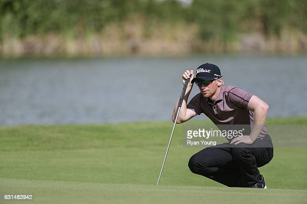 Anders Albertson lines up a putt on the first hole during the final round of The Bahamas Great Exuma Classic at Sandals Emerald Bay Course on January...