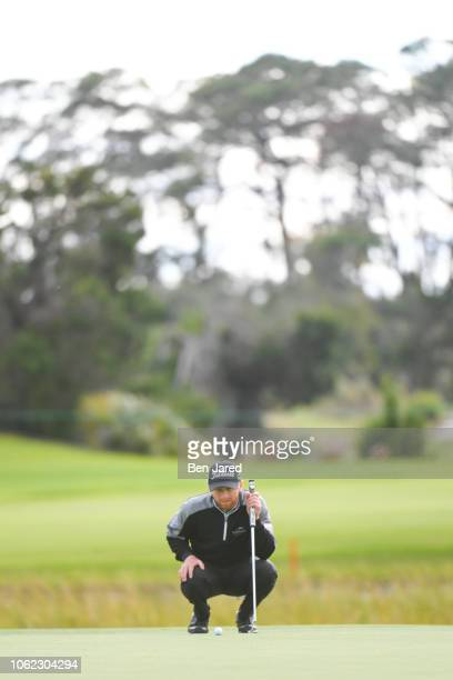Anders Albertson reads his putt on the seventh hole green during the first round of The RSM Classic at the Sea Island Resort Seaside Course on...