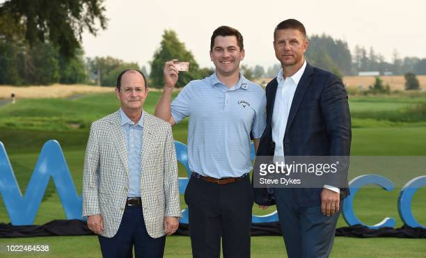 Anders Albertson receives his PGA Tour card from Webcom CEO David Brown and Bill Calfee president of the Webcom tour during a presentation ceremony...