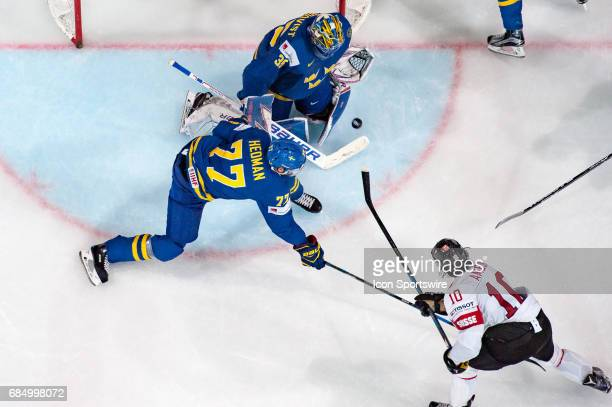 Anders Ambuhl tries to score against Goalie Henrik Lundqvist and Victor Hedman during the Ice Hockey World Championship Quarterfinal between...
