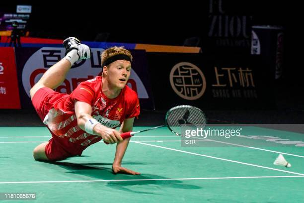 Anders Antonsen of Denmark tries to reach the ball during his men's singles semifinal match against Chou Tien Chen of Taiwan at the Fuzhou China Open...