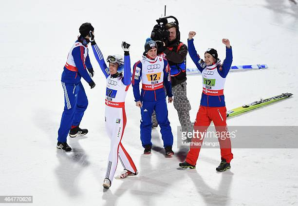 Anders Bardal Anders Jacobsen Anders Fannemel and Rune Velta of Norway celebrate after winning the gold medal in the Men's Team HS134 Large Hill Ski...