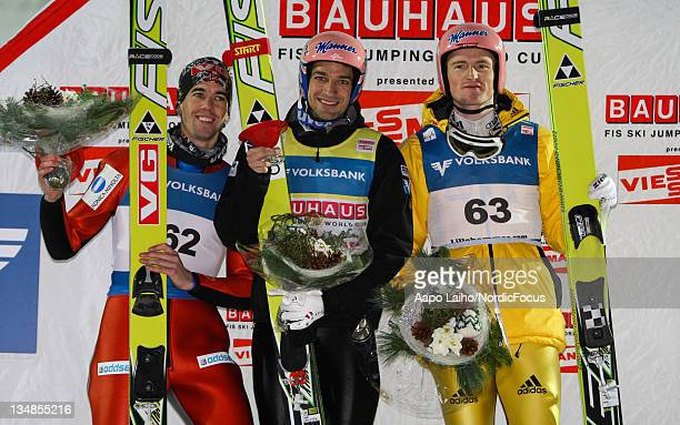 Anders Bardal of Norway Andreas Kofler of Austria and Severin Freund of Germany pose on the podium after the Men's Ski Jumping HS138 during day two...