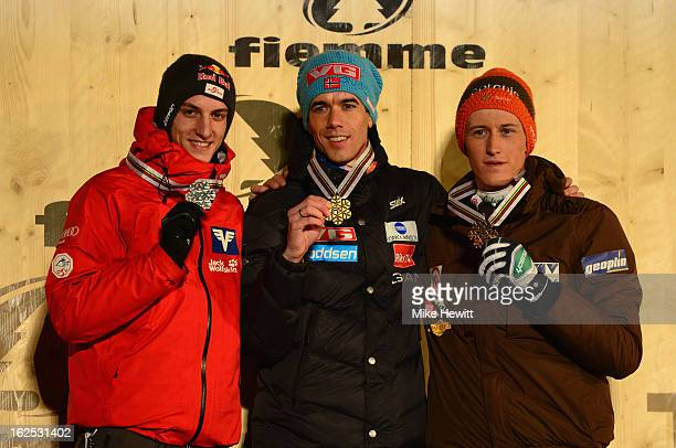 Anders Bardal of Norway celebrates Gold on the podium with Kamil Stoch of Poland and Gregor Schlierenzauer of Austria at the medal ceremony for the...