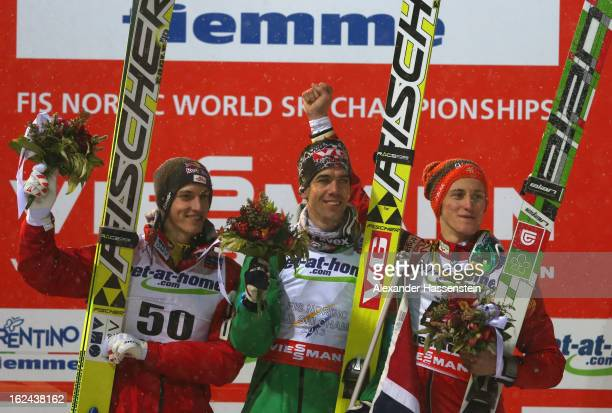 Anders Bardal of Norway celebrates victory on the podium with second placed Kamil Stoch of Poland and third placed Gregor Schlierenzauer of Austria...
