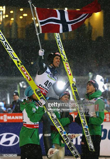 Anders Bardal of Norway celebrates victory with his teammates following the Men's Ski Jumping HS106 Final Round at the FIS Nordic World Ski...