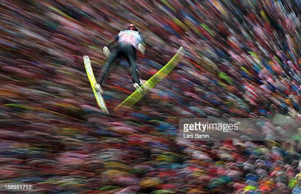 Anders Bardal of Norway competes during the first round for the FIS Ski Jumping World Cup event of the 61st Four Hills ski jumping tournament at...