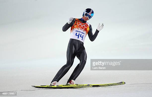Anders Bardal of Norway reacts after landing his jump in his Men's Normal Hill Individual Final on day 2 of the Sochi 2014 Winter Olympics at the...