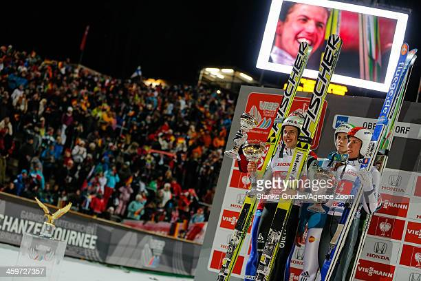 Anders Bardal of Norway takes 2nd place Simon Ammann of Switzerland takes 1st place Peter Prevc of Slovenia takes 3rd place Diethart Thomas of...
