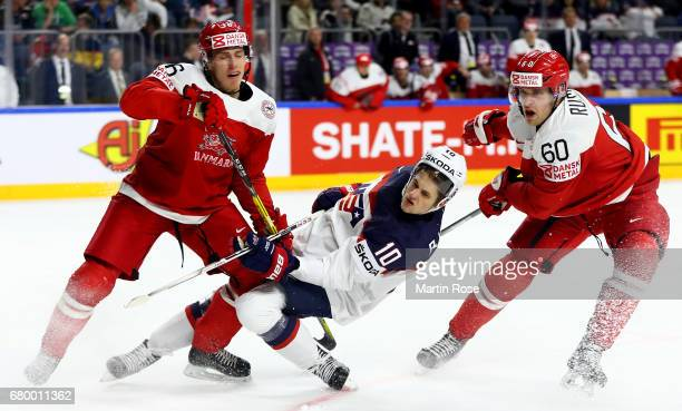 Anders Bjork of USA challenges of Denmark Patrick Russell for the puck during the 2017 IIHF Ice Hockey World Championship game between USA and...