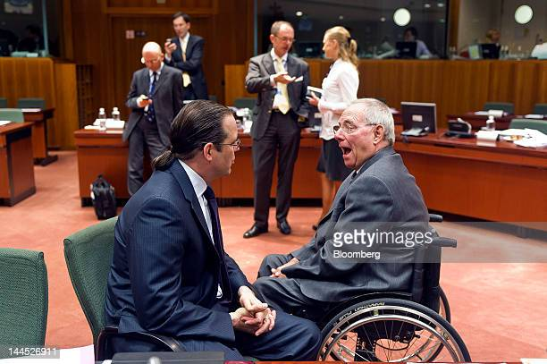 Anders Borg Sweden's finance minister center left speaks with Wolfgang Schaeuble Germany's finance minister right ahead of a European Union finance...